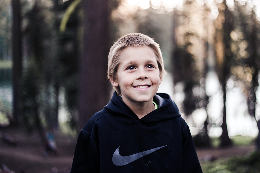 Smiling Kid in Forest